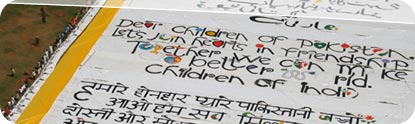 Boy holds up artwork at World's Largest Love Letter event